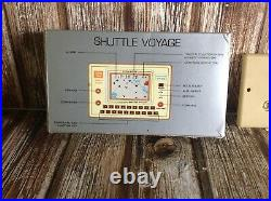 SHUTTLE VOYAGE VINTAGE HANDHELD TABLETOP ARCADE GAME and WATCH CALCULATOR BOX